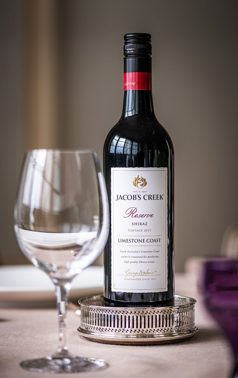 jacob s creek reserve bottle with wine glass